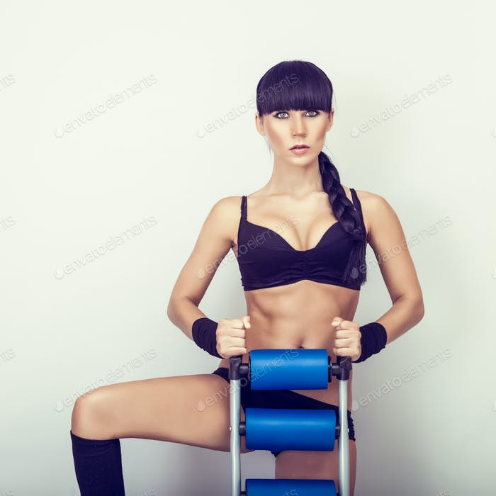 beautiful woman with athletic trainer press