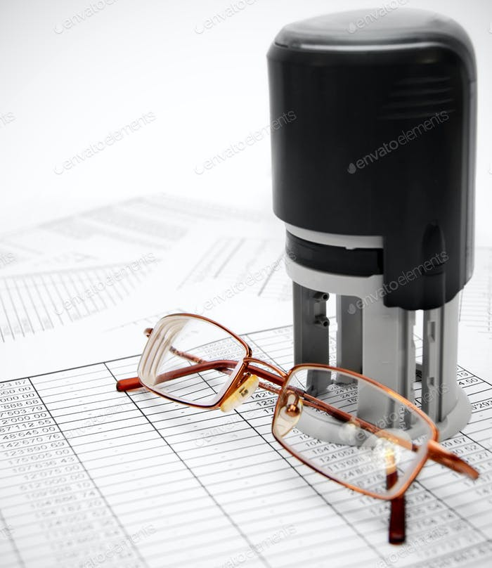 Press and glasses on documents.