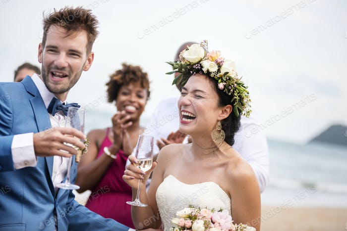 Happy newlyweds at beach wedding