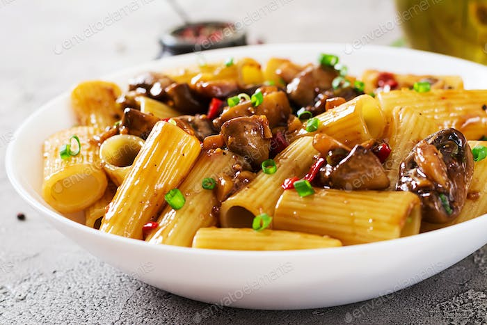 Vegetarian pasta  rigatoni with mushrooms and chilli peppers