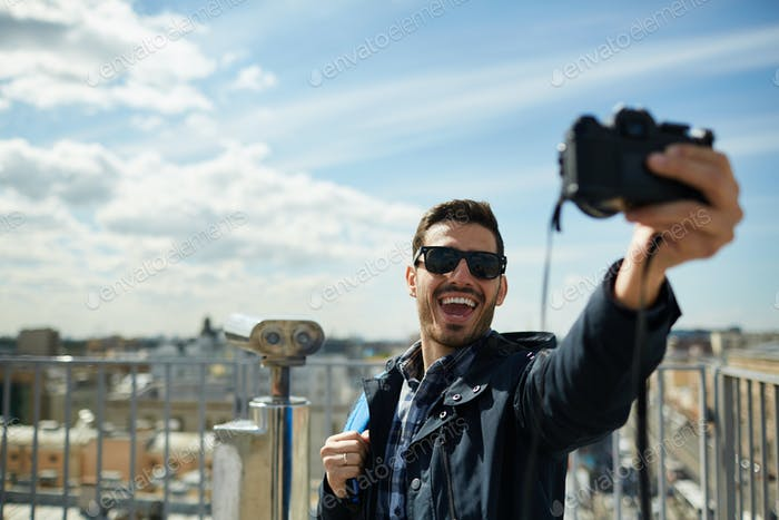 Excited Tourist Taking Selfie on Rooftop