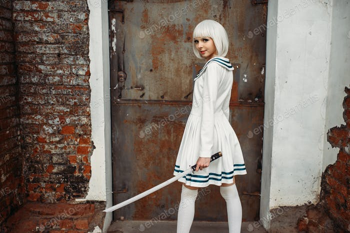 Anime girl with sword poses on abandoned factory