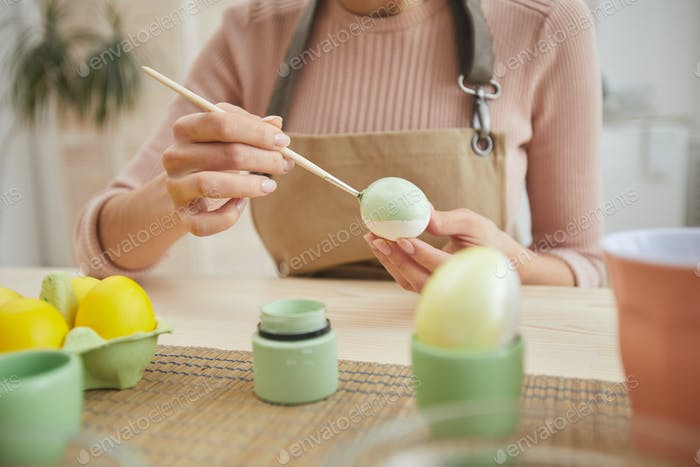 Woman Painting Easter Eggs Close up