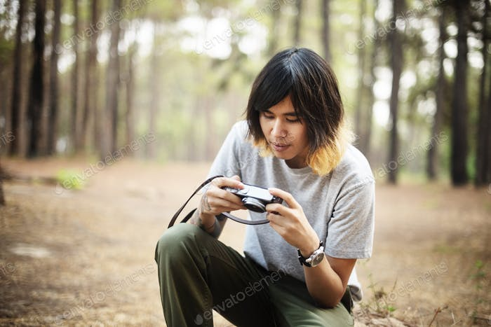 Asian Photographer Taking Pictures Outdoors Concept