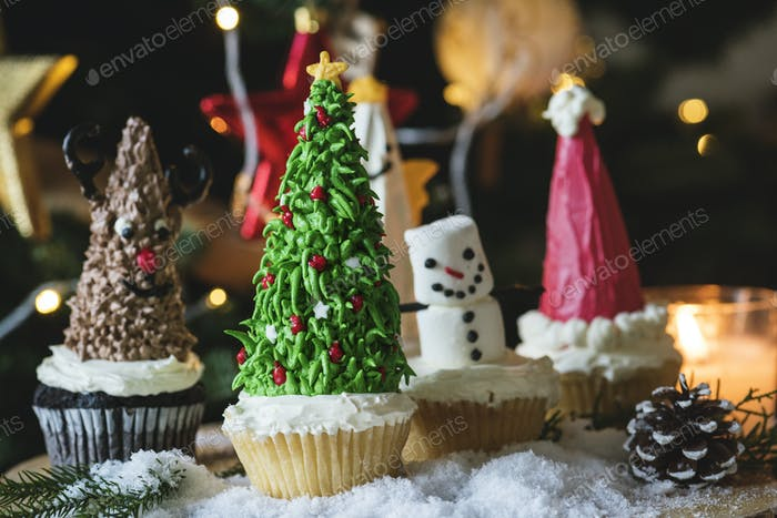 Set of cute Christmas cupcakes