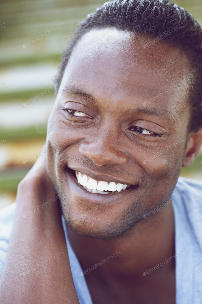 Handsome young african american man smiling