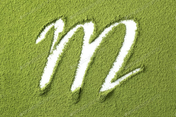 Green Japanese Matcha tea powder full frame and the letter M