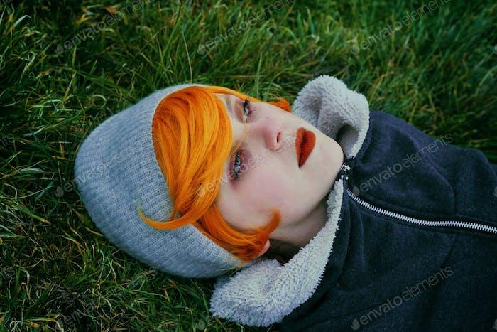 Young redhead woman staring at infinite