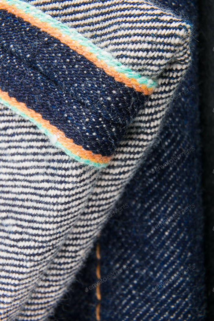 Close up of jeans fragment selvage. Denim texture.