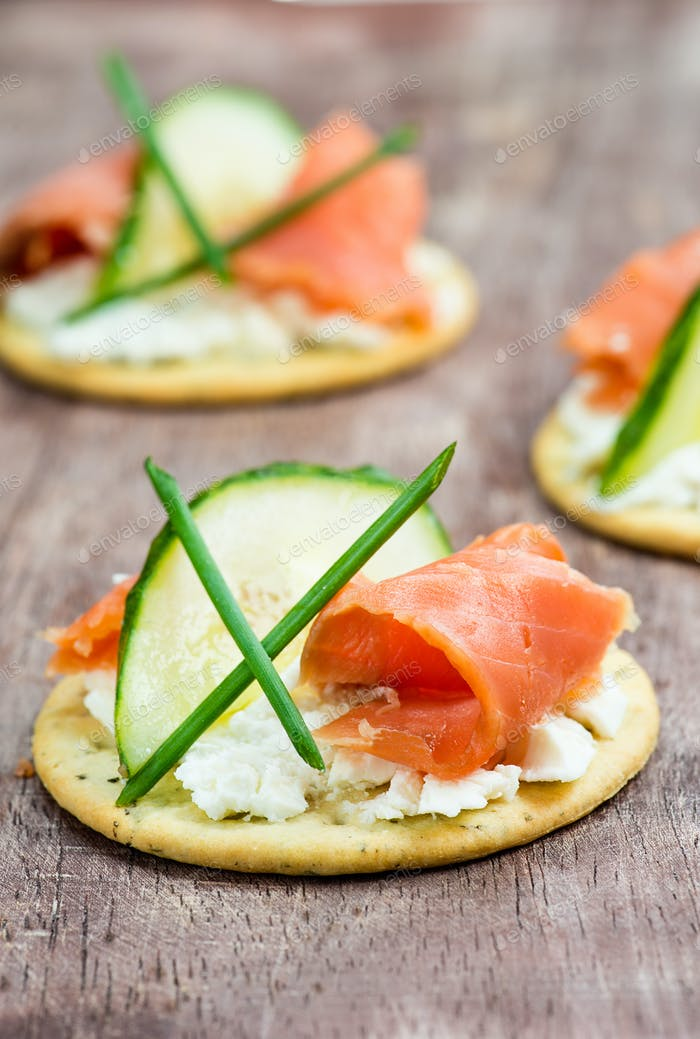 Canapes with smoked salmon, cucumber and  cream cheese