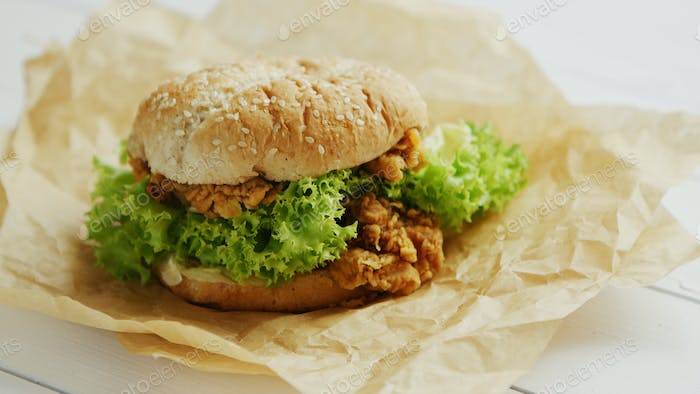 Chicken burger lying on parchment