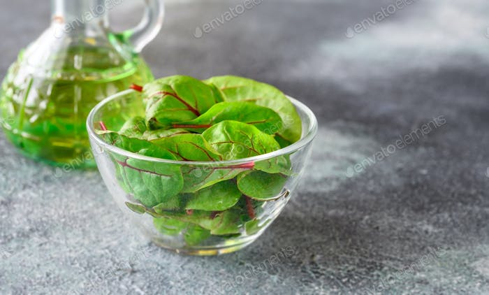 Glass bowl of red chard