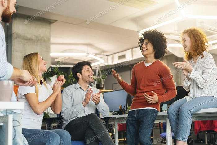 Creative team enjoying communication in modern office