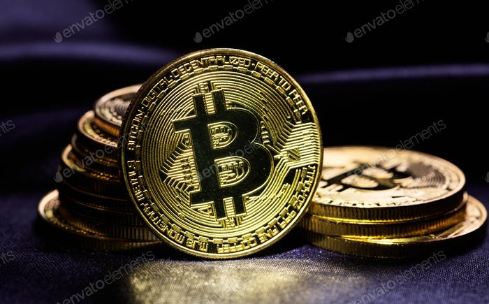 Bitcoins stack on black background