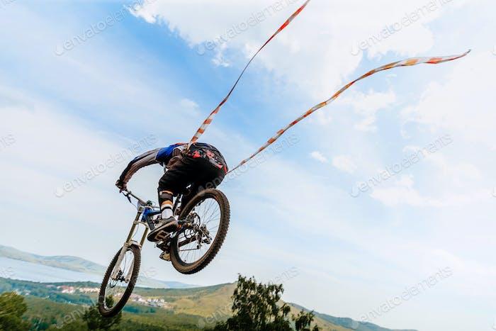 cyclist jump downhill