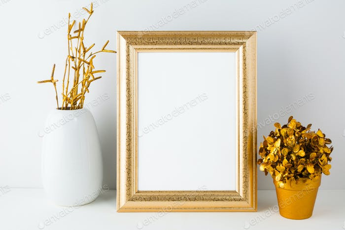 Gold fame mockup with white vase and golden flowerpot