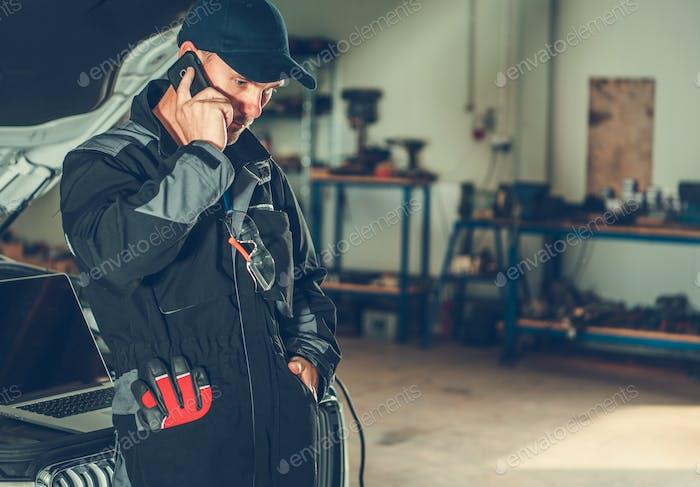 Car Mechanic Making Call
