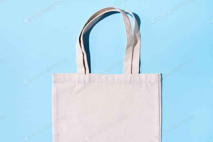 Reusable textile bag on green background. Zero waste concept with copy space. Zero waste, plastic