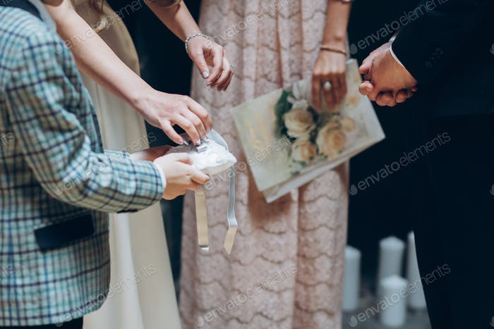 Boy holding pillow with wedding rings at wedding ceremony
