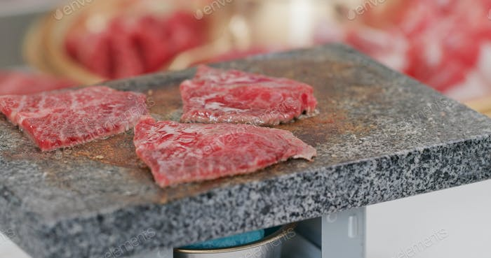 Barbecue beef cook on stone rock