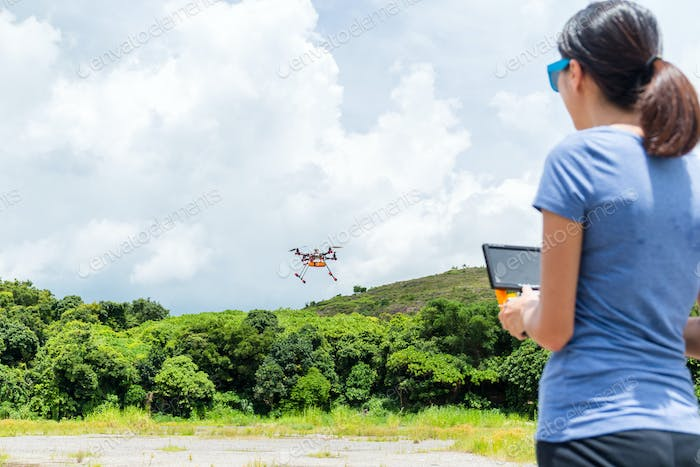 Woman control drone with remote