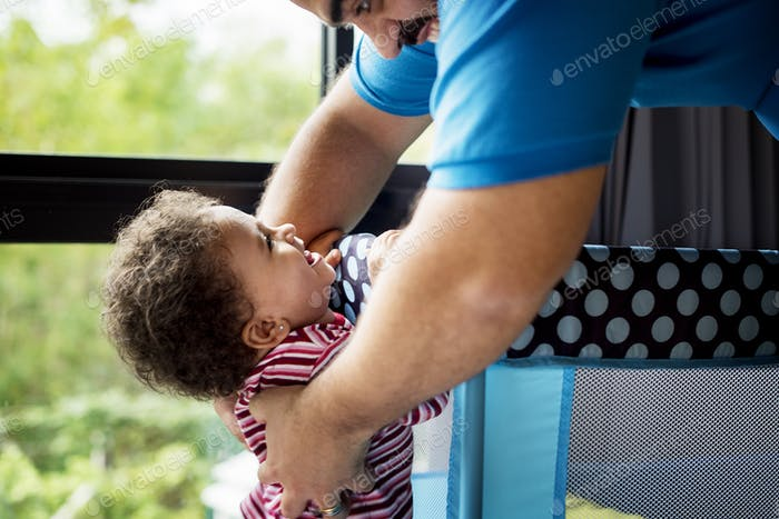 Brazilian father playing with daughter