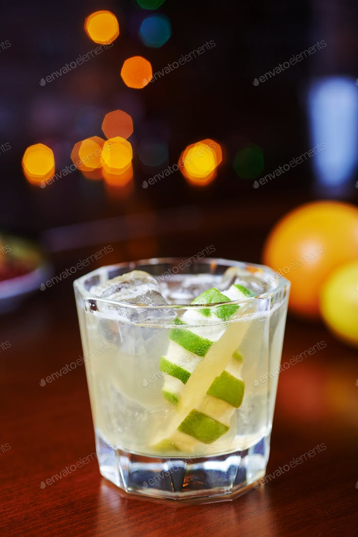 bright glass of alcoholic cocktail or lemonade on a table in a bar. soft focus.