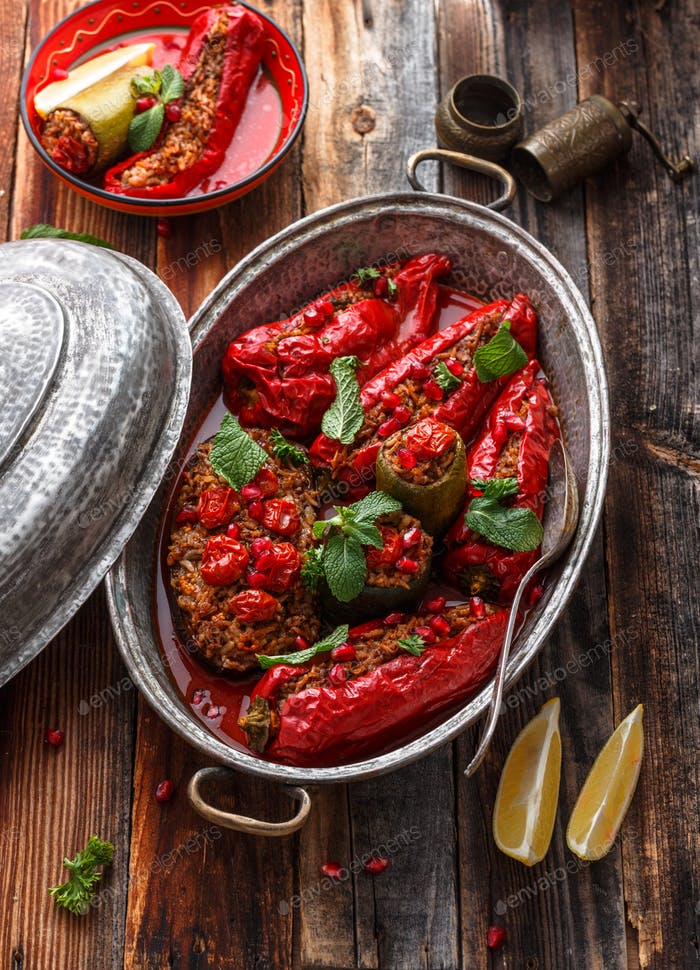Baked red paprika stuffed with rice and walnuts, rustic style, copy space