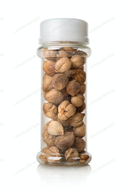 Black cardamom in a glass jar