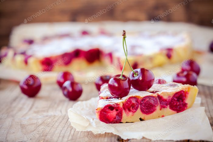 slice of cherry pie on a wooden background