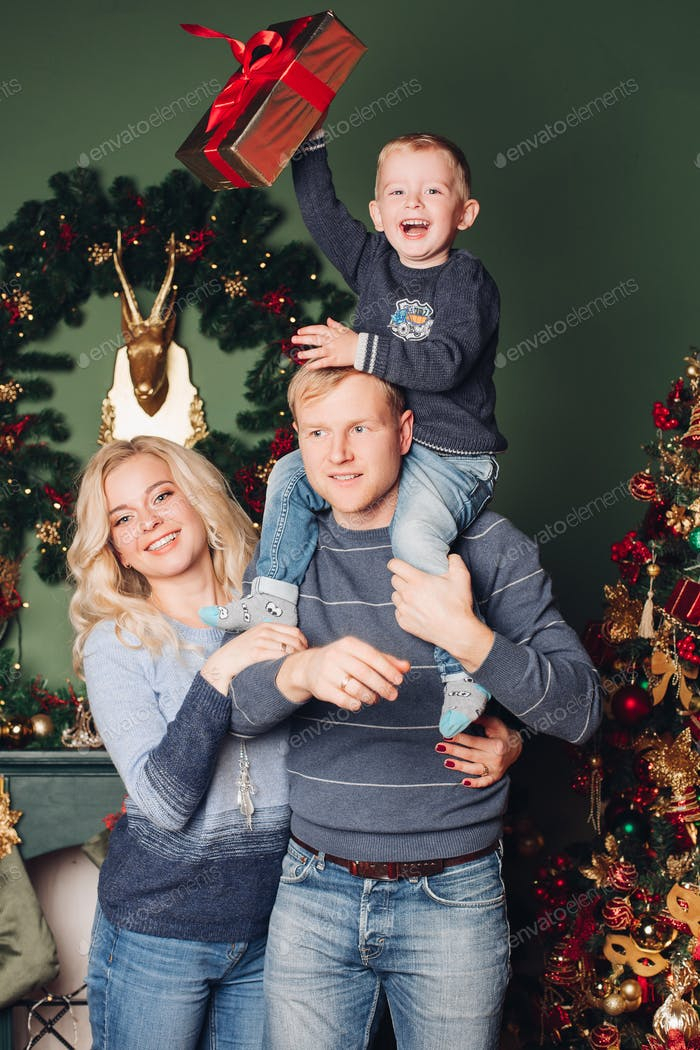 Christmas family photo, dad, son and mom