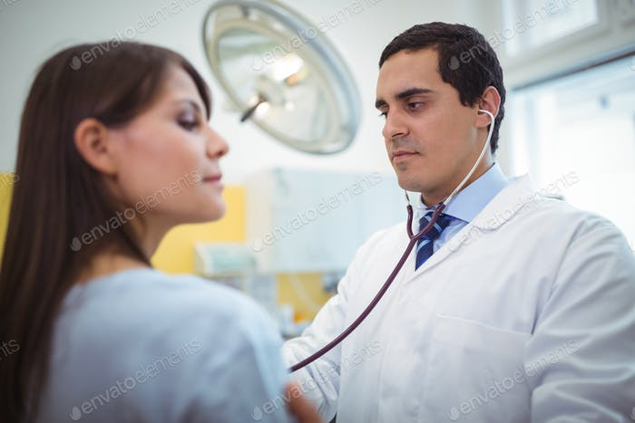 Doctor examining a female patient