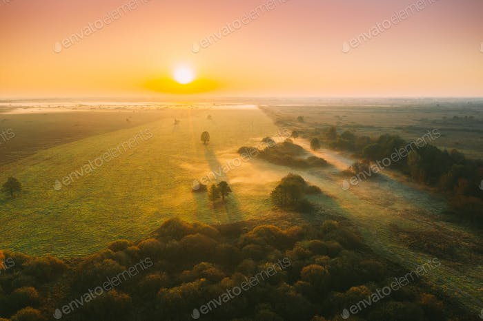 Aerial View Of Misty Autumn Field And Forest Landscape.