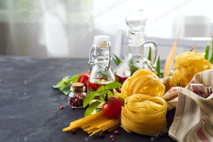 Fresh homemade pasta ingredients on a stone table , copy space
