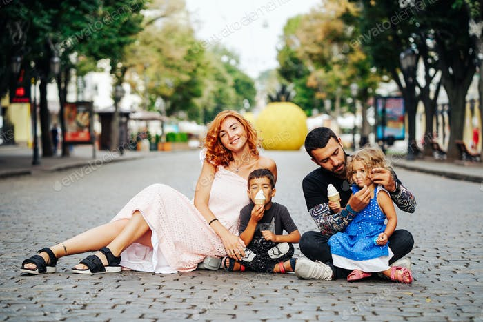 beautiful young family with ice cream