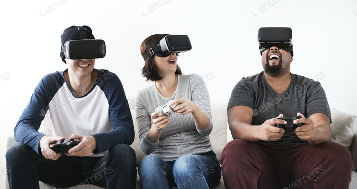 Group of diverse friends enjoying virtual reality game