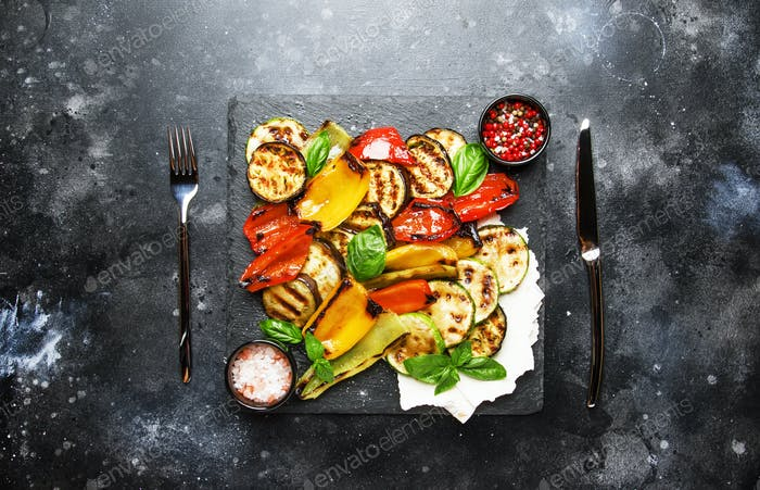 Grilled multicolored vegetables, aubergines, zucchini, peppe