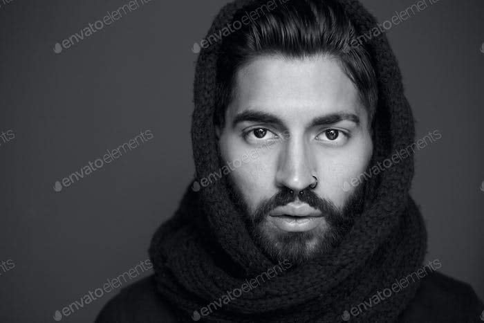 Black and white portrait of a man with wool scarf