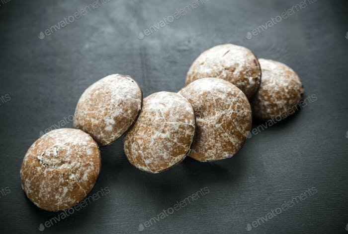Gingerbread cakes on the wooden background