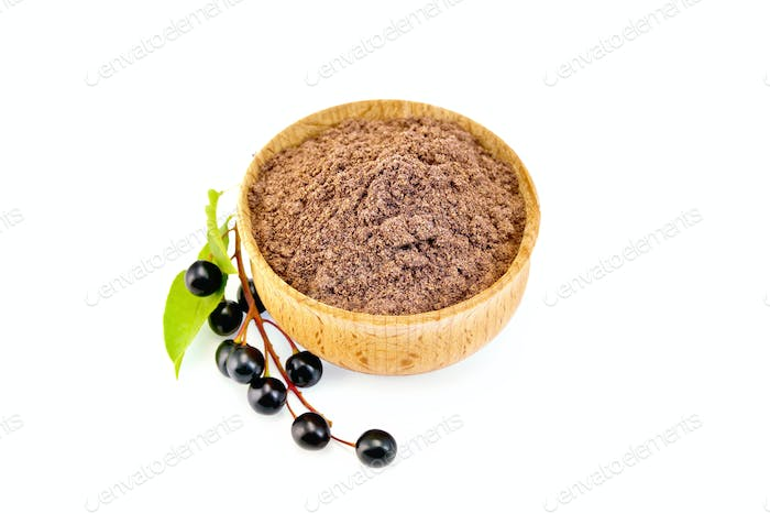 Flour bird cherry in bowl with berries