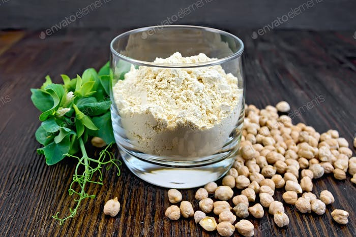 Flour chickpeas in glassful with peas on board