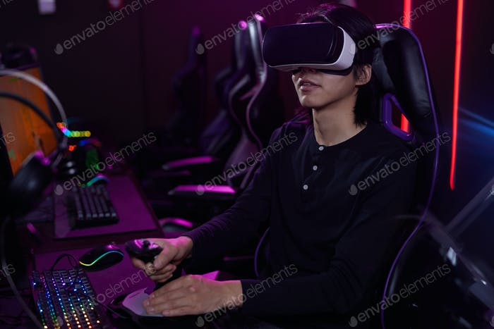 Young Man Playing VR Videogame