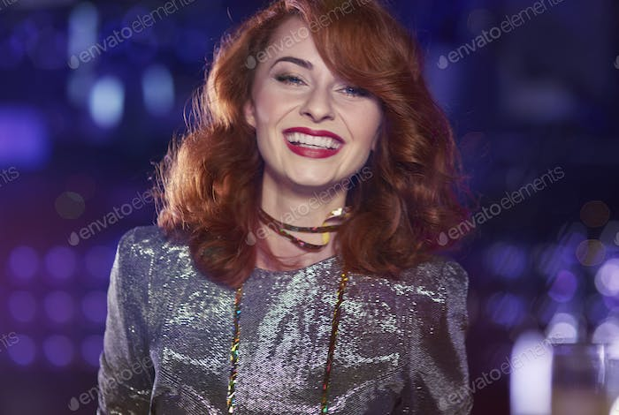 Shot of elegant red haired woman