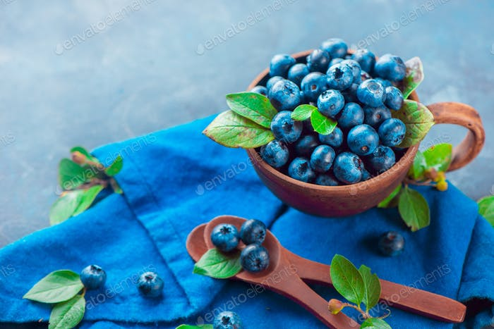 Blueberries in a ceramic cup
