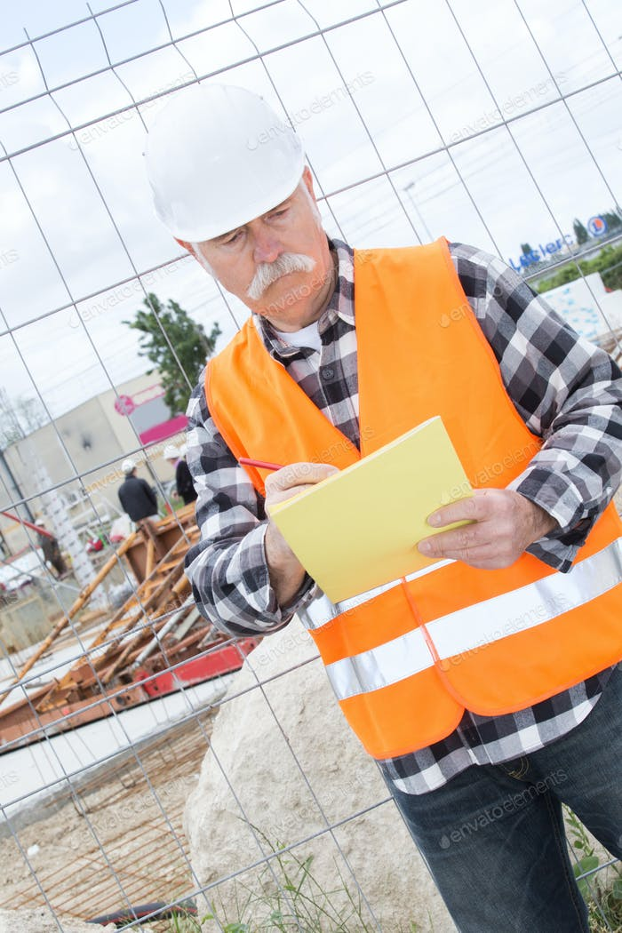 construction manager standing on building site