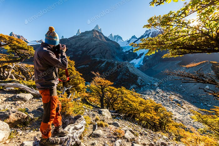 Bearded tourist man in the background of a mountain landscape