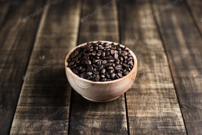coffee beans with wooden bowl
