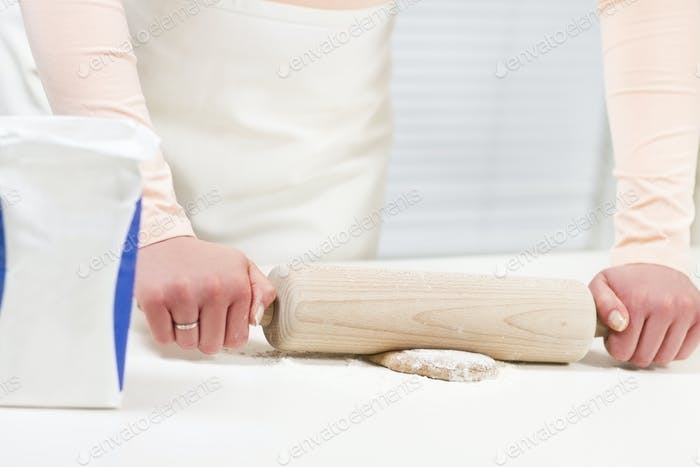 Woman Baking and Rolling Dough