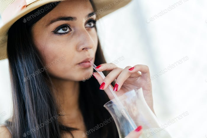 Relaxed woman drinking beverage