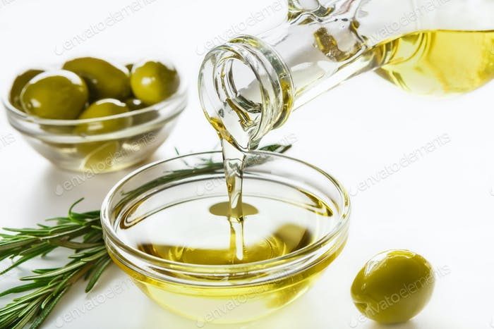 Olive oil and olives in bowls